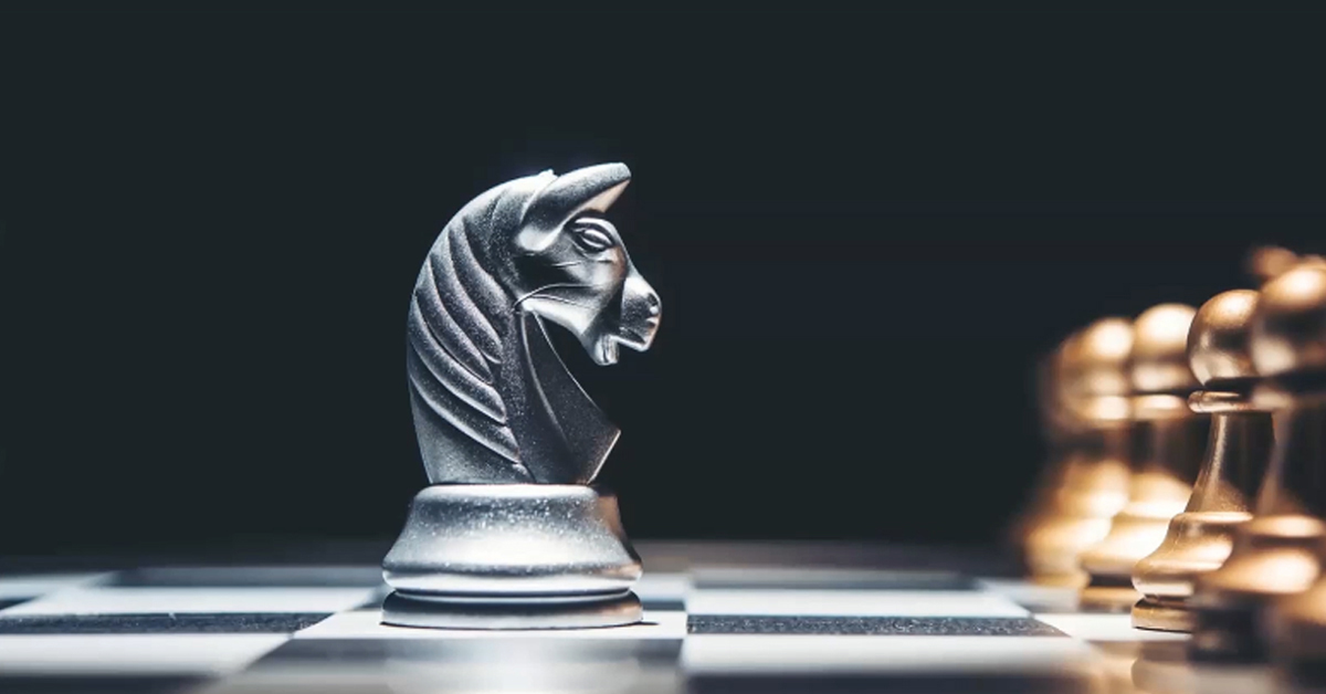 Photo of a Knight Chess piece in front of Pawns on a black background